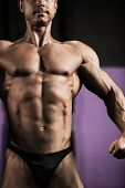 Close-up of strong athletic man posing