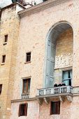 Monks Are On Balcony In Montserrat Benedictine Monastery, Spain