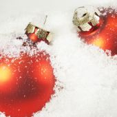 Close-up Of Red Christmas Balls In White Snow (shallow Dof)