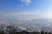 INNSBRUCK, AUSTRIA - MARCH, 2013 - Bird view of the City of Innsbruck on March 27, 2013. The view is from Hafelekarspitze in Tirol, Austria