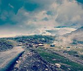 Vintage retro effect filtered hipster style travel image of Road in Himalayas on top of  Rohtang La