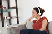 Woman with headphones chating on internet poster