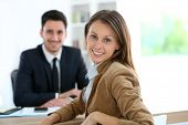 Woman meeting financial adviser for business project