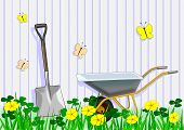 picture of wheelbarrow  - A shovel and a wheelbarrow standing on a white painted wall - JPG