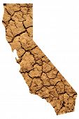 Map shape of California with dry parched earth representing drought conditions due to Climate Change