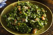 stock photo of tabouleh  - Healthy Organic Tabbouleh Salad with Tomatos and Parsley - JPG