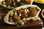 stock photo of green pea  - Healthy Vegetarian Falafel Pita with Rice and Salad - JPG