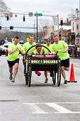 Clergymen Push Holy Rollers Bed In Annual Fundraiser Race