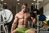 Man Working Out In A Health Club