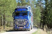 Blue Volvo FH16 750 Timber Truck On Forest Road