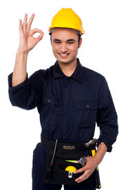 picture of plumper  - Happy worker on white background showing ok sign