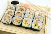 Breaded And Teriyaki Chicken Sushi On Bamboo Tray Against White Background