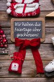 German text on a billboard: We have open on christmas holidays. Sign for customers.