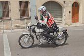 Biker Riding A Vintage Ducati 450 Desmo Silver Shot Gun