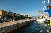 GALAXIDI, GREECE - SEP 29, 2014: Mooring. Unidentified sailors participate in sailing regatta