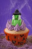 Halloween cupcakes with a witch