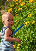 Baby Is Watering The Flowers