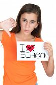 Teenage girl holding a sign with the words I hate school isolated on white