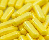 Yellow Drug Capsules Closeup