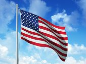 stock photo of waving american flag  - American Flag in blue sky background - JPG