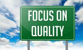Focus on Quality in Green Highway Signpost.