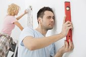 Couple working together in new house