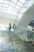 Businesswomen walking on steps in office