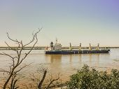 Commercial Ship Crossing The Parana River