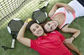 Couple Resting In Paddle Tennis Court