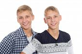 Two blond twin brothers isolated on white background