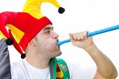 soccer fan blowing on vuvuzela