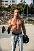 Shirtless Hunk Man Carrying Weights