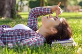 Woman Lies On The Grass In The Park