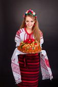 Young Woman In Ukrainian Clothes, With Garland And Round Loaf
