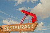 Restaurant Sign With Arrow