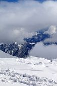 View On Winter Snowy Mountains In Clouds