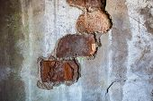 Bricks Visible In The Split Plaster Of The Old Wall