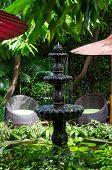 Stone Fountain In The Garden