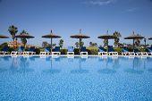 Hammocks Umbrellas In Swimming Pool