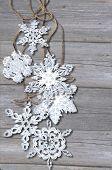 Snowflake  On  Wood Background