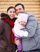 Beautiful Happy Family Wering Warm Clothes