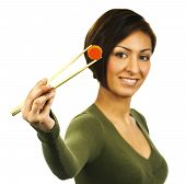 Young Happy Woman Holds A Carrot Slice With Chopsticks