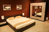 stock photo of guest-house  - brown bedroom - JPG