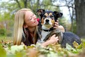 Woman Relaxing With Her German Shepherd Dog On Fall Day