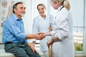 image of congrats  - doctor shakes hands with a senior patient - JPG