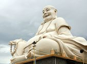 Big Buddha statue over cloudy sky