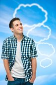 Teenager with blank thought bubbles on blue sky background