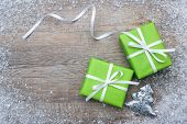 Gift boxes with bow and snowflakes on wooden background