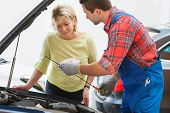 Auto mechanic and female customer in auto repair shop
