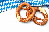 Appetizing pretzels with a bavarian flag on white background